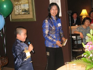 Perry Chen speaking at Chinese film delegation reception while mom Dr. Zhu Shen is the emcee on July 31