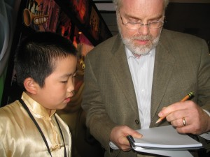 Perry Chen getting autograph from director Ron Clements of Princess & Frog