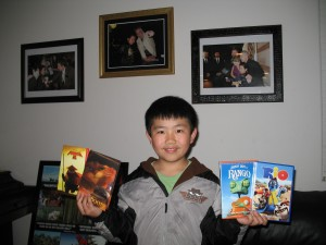 Perry Chen thrilled to receive screening DVDs for Animated Films (photo by Zhu Shen)
