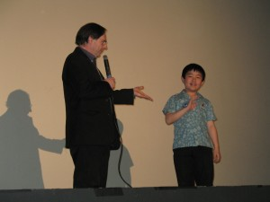 Cartoon Brew Publisher Jerry Beck Introducing Perry Chen on Stage at 2012 L.A. Animation Festival (photo by Zhu Shen)