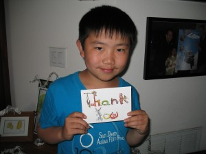 Perry Chen holding Thank-You card he designed (photo by Zhu Shen)