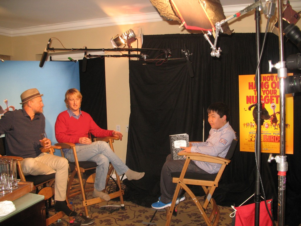 647a91b7f06 Perry Chen interviewing Owen Wilson   Woody Harrelson at Free Birds press  junket (photo by