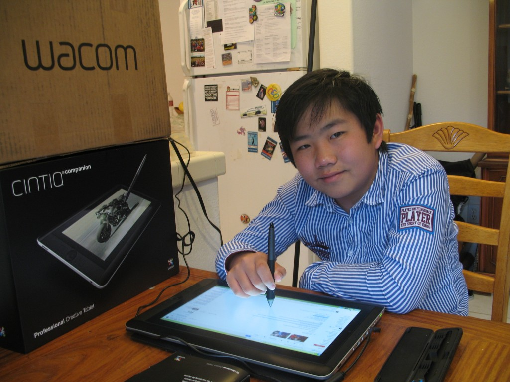 Perry Chen Using Sponsor Wacom's wireless Cintiq Companion (photo by Zhu Shen)