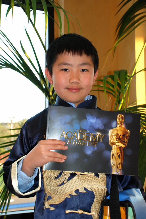 Perry Chen at 2012 Oscar Night America -San Diego with official Oscars brochure (photo by Brian Bostrom)