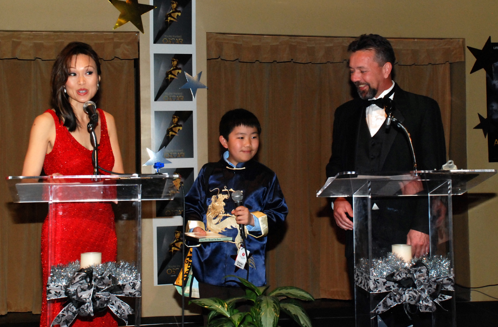 Perry Chen predicting Oscar winners on stage with cohosts, ABC 10 News anchor Virginia Cha & Tom Madeyski at 2012 Oscar Night America -San Diego (photo by Brian Bostrom)