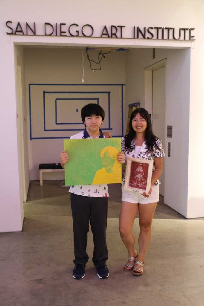 Perry Chen with his mom Zhu Shen holding Perry's art at San Diego Art Institute