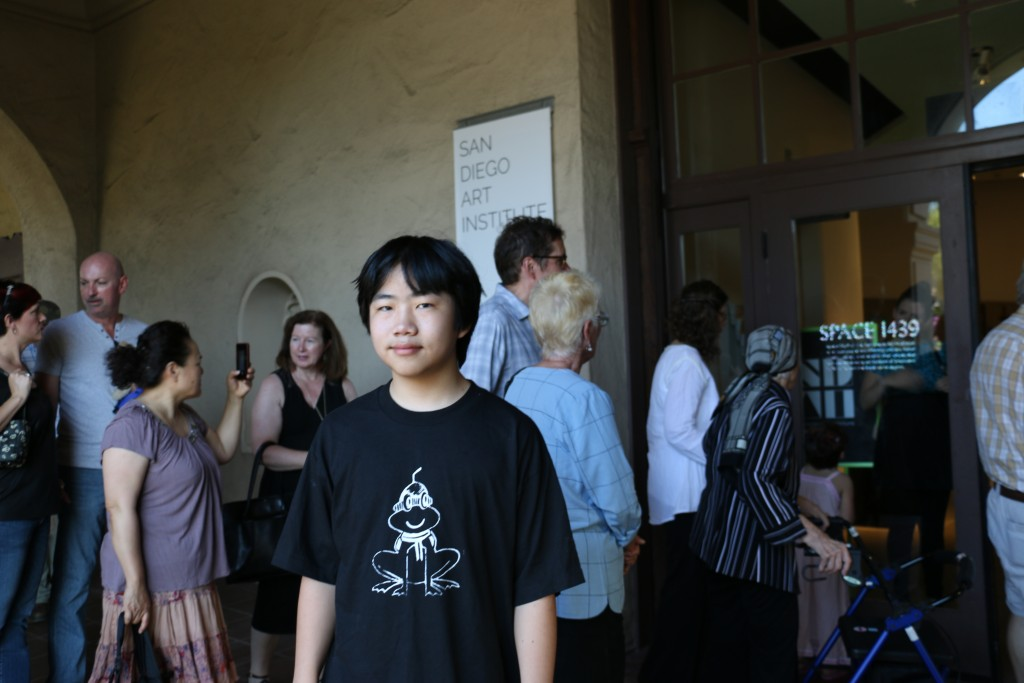 Perry Chen at San Diego Art Institute entrance (photo by Zhu Shen)
