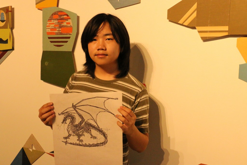 Perry with dragon drawing at San Diego Art Institute (photo by Zhu Shen)