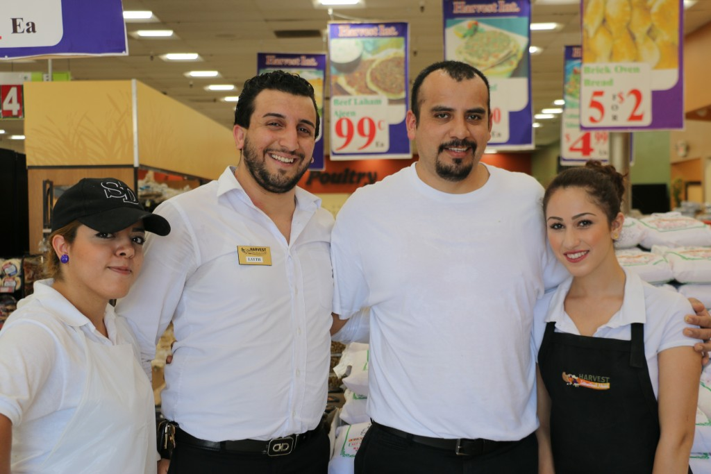 Harvest International Market manager Layth Yaqoob (L2) with coworkers (photo by Zhu SHen)