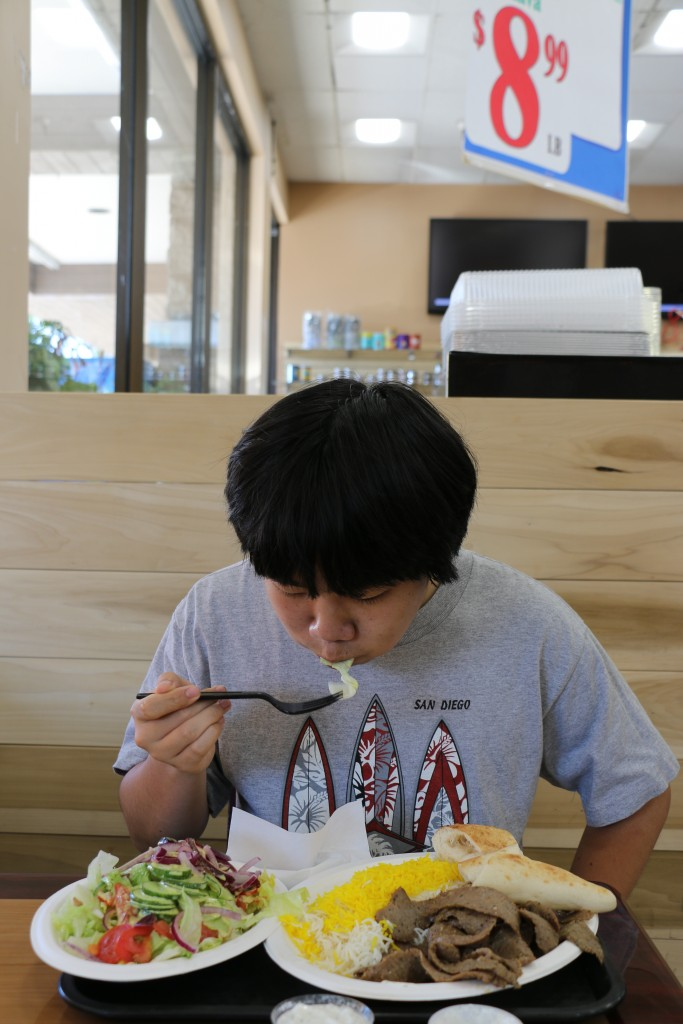 Perry Chen devouring the Gyros Plate (photo by Zhu Shen)