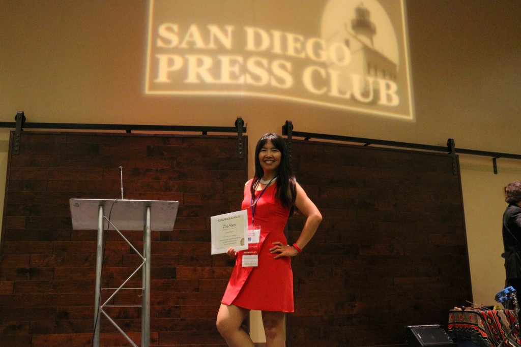Zhu Shen holding awards at 2015 San Diego Press Club Awards (photo by Perry Chen)