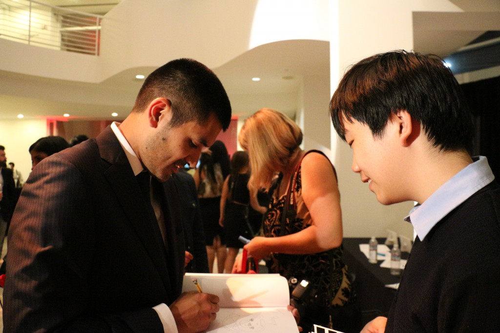 "Perry Chen watching ""Bear Story"" director Gabriel Osorio draw for him at ShortsHD awards (photo by Zhu Shen)"
