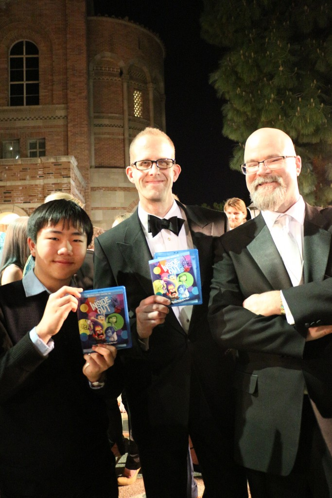 Perry Chen with Oscar-nominated, Annie Awards-winning Pixar director of Inside Out, Pete Docter (M) and his autographed DVD at 2016 Annie Awards (photo by Zhu Shen)