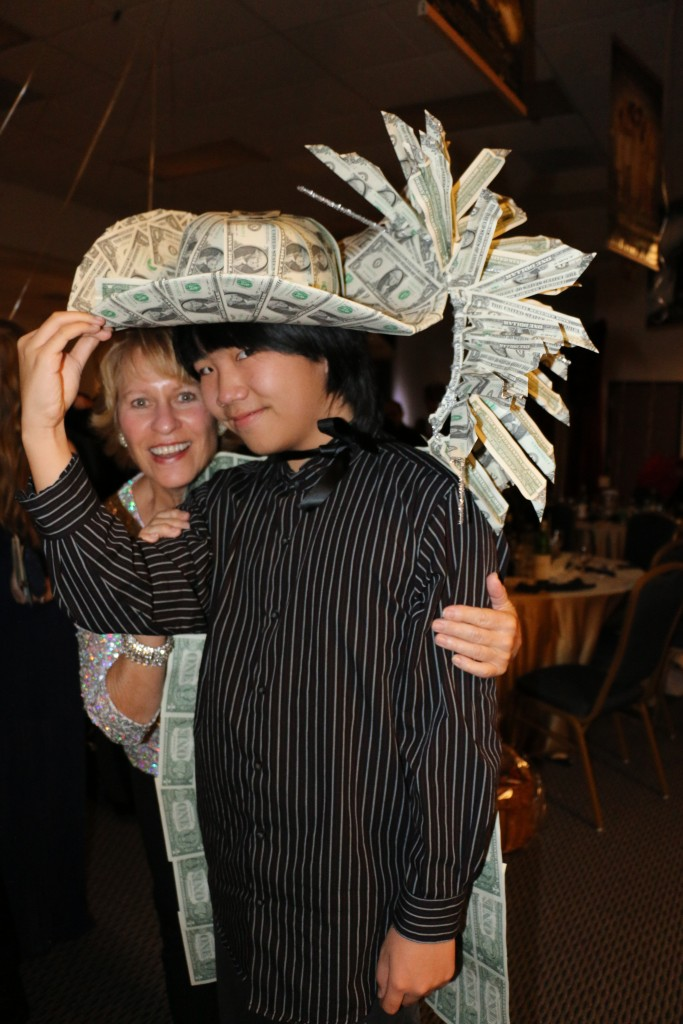 "Perry Chen wearing the famous ""Money Hat"" with hatmaker at the 2015 Oscar Night Gala fundraiser (photo by Zhu Shen)"